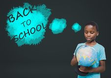 Back to school text and boy holding world globe Royalty Free Stock Photo