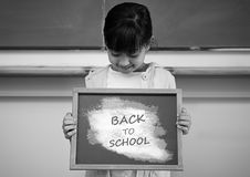 Back to school text and girl holding sign Stock Photo