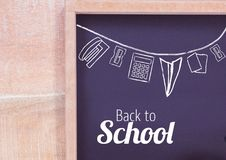 Back to school text and stationery on blackboard Stock Photo