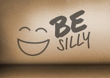 Be Silly text and smiley face in room. Digital composite of Be Silly text and smiley face in room royalty free stock photos