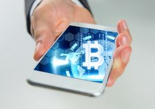 Bitcoin icon on phone in hand stock photos