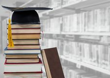 Books and graduation hat in education library. Digital composite of Books and graduation hat in education library stock photo