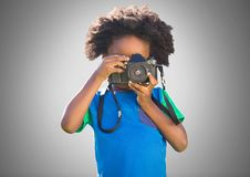 Boy against grey background with camera. Digital composite of Boy against grey background with camera Stock Images