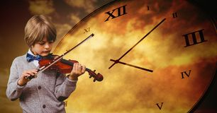 Boy against grey background playing violin and time clock. Digital composite of Boy against grey background playing violin and time clock Royalty Free Stock Images
