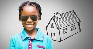 Boy against grey background with sunglasses and house royalty free stock photo