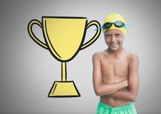 Boy against grey background with swimming gear and trophy Royalty Free Stock Photos