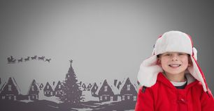 Boy against grey background with Winter Christmas warm clothes and Christmas illustrations. Digital composite of Boy against grey background with Winter Stock Image