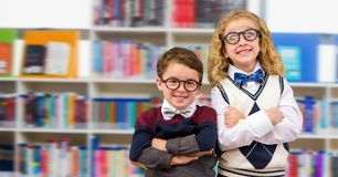 Boy and girl in education library royalty free stock image