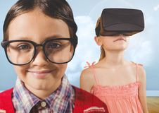 Boy with glasses and girl with VR headset in cloudy room. Digital composite of Boy with glasses and girl with VR headset in cloudy room Stock Photography
