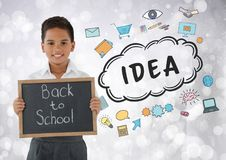 Boy holding back to school blackboard with idea graphics. Digital composite of Boy holding back to school blackboard with idea graphics Stock Photo