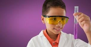 Boy scientist with test tube and purple background Royalty Free Stock Image