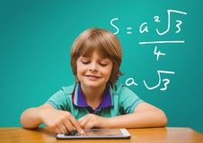 Boy with tablet and formula. Digital composite of Boy with tablet and formula Stock Photos