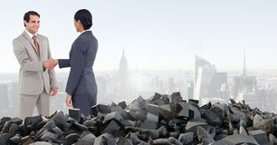 Broken concrete pile and business people in cityscape Stock Photo