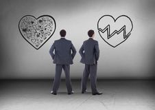 Broken heart or heart with Businessman looking in opposite directions Royalty Free Stock Photography