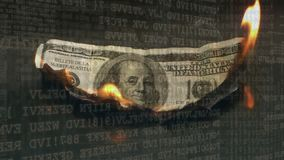 Dollar bill burning. Digital composite of a burning dollar bill with computer codes in the background stock video