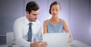 Business couple working on laptop. Digital composite of Business couple working on laptop Royalty Free Stock Photo