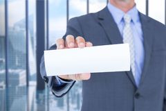 Business man holding blank card in office Royalty Free Stock Image