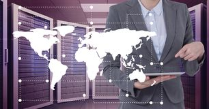 Business man holding a tablet and graphics in server room. Digital composite of Business man holding a tablet and graphics in server room Stock Image