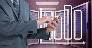 Business man holding a tablet and graphics in server room. Digital composite of Business man holding a tablet and graphics in server room Stock Photos