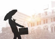 Business man silhouette against city Royalty Free Stock Photography