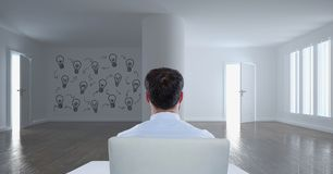 Business man sitting in a 3D room with a conceptual graphic on the wall Royalty Free Stock Images