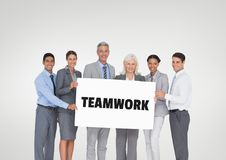 Business people holding a card with teamwork text stock photos