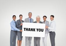 Business people holding a card with thank you text. Digital composite of Business people holding a card with thank you text Royalty Free Stock Photos