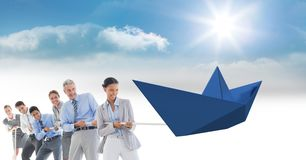 Business people pulling paper boat with rope Royalty Free Stock Photo