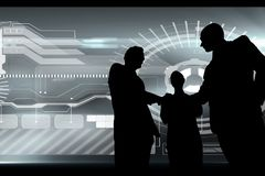Business people shaking hand silhouette against business interface. Digital composite of Business people shaking hand silhouette against business interface Royalty Free Stock Photography
