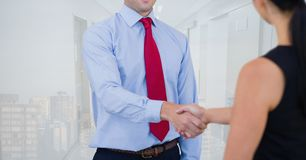 Business people shaking hands against office and city background Royalty Free Stock Photography