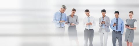 Business people using phones and tablets against white background. Digital composite of Business people using phones and tablets against white background stock photography