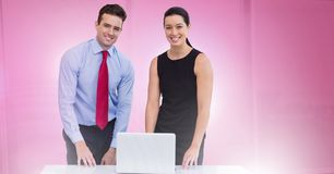 Business people working on laptop. Digital composite of Business people working on laptop Royalty Free Stock Image