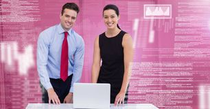 Business people working on laptop with screen text interface. Digital composite of Business people working on laptop with screen text interface Royalty Free Stock Image