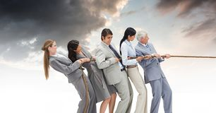 Business person paper boats_Business people pulling rope in group with sky. Digital composite of Business person paper boats_Business people pulling rope in Royalty Free Stock Photo