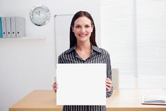 Business woman holding blank card in office Stock Image