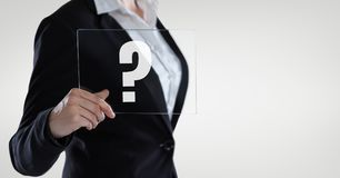 Business woman holding a glass with question marks  text Royalty Free Stock Image
