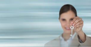 Business woman holding keys. Digital composite of Business woman holding keys Royalty Free Stock Image