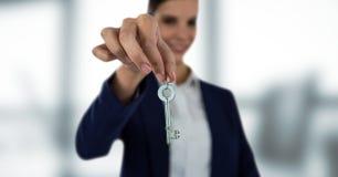 Business woman holding keys. Digital composite of Business woman holding keys Stock Photography