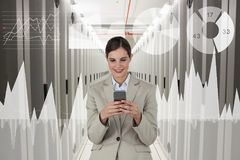 Business woman holding a phone and graphics in server room Royalty Free Stock Images
