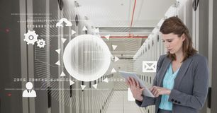 Business woman holding a tablet and graphics in server room Stock Images