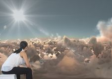 Business woman looking across clouds at something. Digital composite of Business woman looking across clouds at something stock image