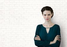 Business woman standing against white wall background Stock Image