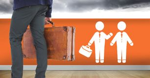 Businessman with briefcase and people meeting icon on wall. Digital composite of Businessman with briefcase and people meeting icon on wall stock images