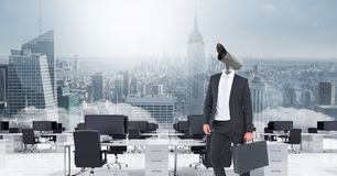 Businessman with CCTV head in office above city skyline. Digital composite of Businessman with CCTV head in office above city skyline royalty free stock image