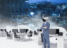 Businessman with CCTV head at office with city skyline. Digital composite of Businessman with CCTV head at office with city skyline Stock Photo