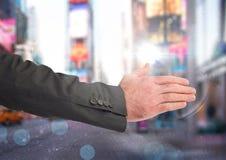 Businessman hand in city rush. Digital composite of Businessman hand in city rush Stock Photography
