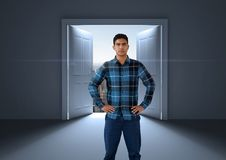 Businessman with hands on hips by open door to city. Digital composite of Businessman with hands on hips by open door to city Royalty Free Stock Photos