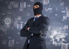 Businessman with hood and arms crossed in front of digital background. Digital composite of Businessman with hood and arms crossed in front of digital background Stock Image