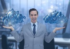 Businessman with open hands and cog gears clouds. Digital composite of Businessman with open hands and cog gears clouds Stock Image