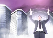 Businessman opening arms with Tall buildings with sci-fi circle glowing. Digital composite of Businessman opening arms with Tall buildings with sci-fi circle Stock Images